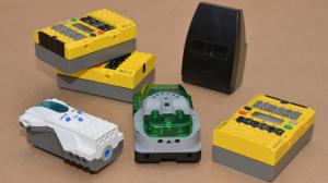 Three RCX, a Spybotics brick and a MicroScout.